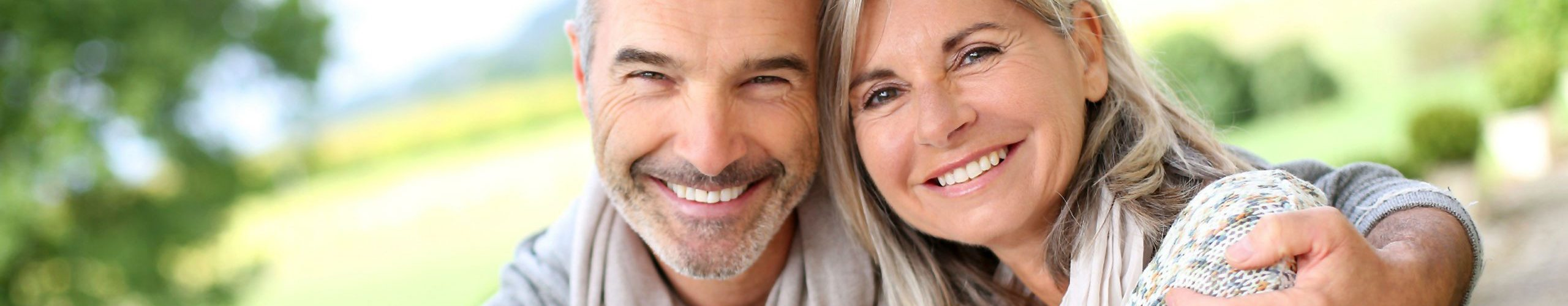 Happy couple with medicare supplements